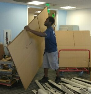 here is one of our movers brining in boxes to move office furniture